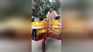Homemade spinning stroller designed for triplets