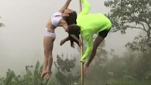Couple falls while doing tricks on dancing pole