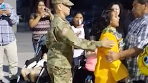 Soldier surprises sister at her grad ceremony