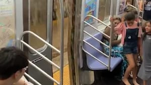 Rainwater pours inside subway train in NYC