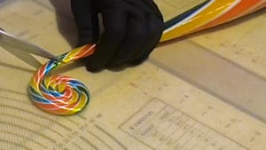 How candymakers create swirly rainbow lollipops