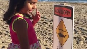 Little girl misreads sign about sharks