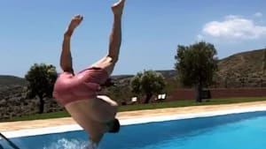 Guy trying backflip into pool falls into water