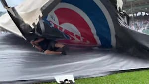 Guy gets caught underneath tarp during Cubs game