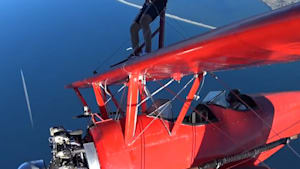 Man walks on wings of plane at 3,500 feet