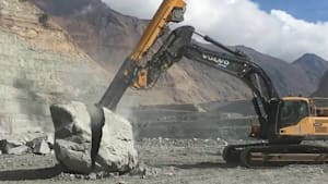 Giant machine obliterates big rocks and concrete