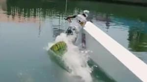 Man tries wakeboarding off ramp in water and falls