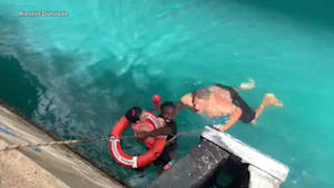 People save woman whose wheelchair fell off ship