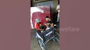 Tourist gifts new wheelchair to disabled man
