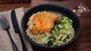 Crispy chicken thighs over melted zucchini