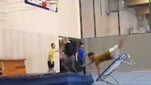 Guy tries to jump off trampoline and faceplants