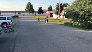 Mom tries to push kid on bike and faceplants