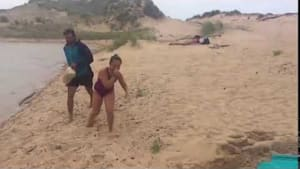 Girl falls for beach towel prank