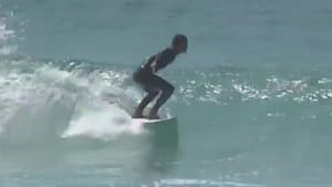 Surfer crashes and gets hit by surfboard in face