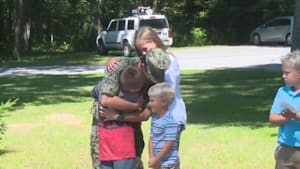 Big brother returns to surprise siblings at school