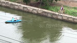 Hero boy paddles across canal to save kitten
