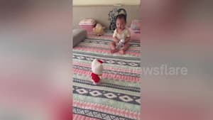 Baby gets scared by voice-activated toy