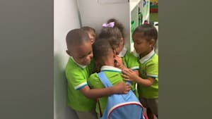 Boy gets hugs from friends after hurricane