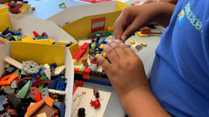 5th graders create a community playing with Legos