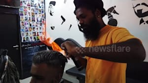 Barber sets people's hair on fire for social media