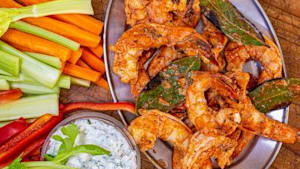 Grilled buffalo shrimp with yogurt blue-ranch dip