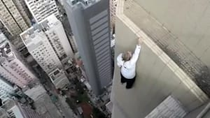 This man does handstands on the edge of buildings