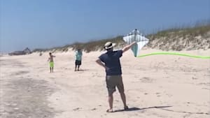 Guy releases kite into air, instantly hits him