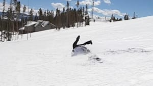 Girl faceplants in snow while powdersurfing