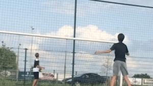 Kid kicks soccer ball through a passing car window