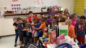 Kid surprised with toys from students