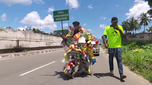 Man wears rubbish vest for littering awareness