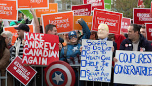 Federal Leaders Arrive To Protests Outside English Language Debate