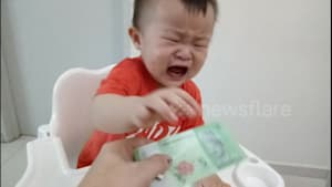 Toddler stops crying instantly when given money