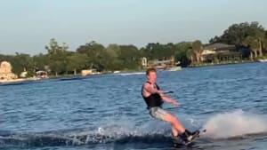 Guy trying to flip while wakeboarding crashes