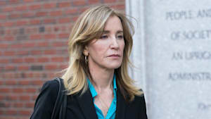 Felicity Huffman serves time in prison uniform