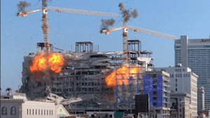 Controlled explosion demolished cranes at hotel