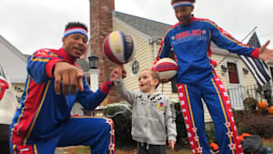 3-year-old with cancer plays with Globetrotters