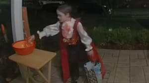 Trick-or-treater kindly refills empty candy bowl