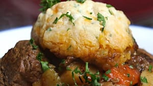 Guinness beef stew topped with cheddar dumplings