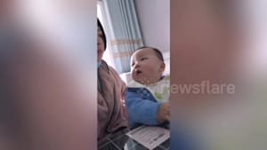 Chinese mother pretends not to eat in front of son
