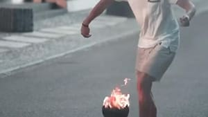 Guy does awesome tricks with a ball that's on fire