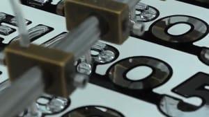 Mesmerizing machine makes labels, graphic overlays