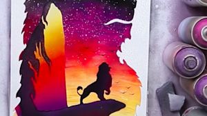 Artist spray paints a scene from 'The Lion King'