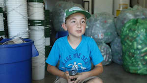 Boy wants to save environment through recycling
