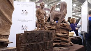 Sculptor turns 450lb. block of chocolate into art
