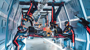 Formula One crew performs pit stop in zero gravity