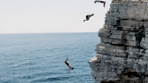 Incredible cliff jumpers perform epic dives