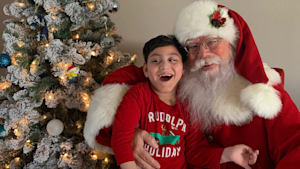 Boy with special needs meets Santa