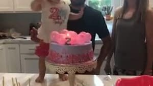 Little girl dances while celebrating her birthday