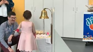 Girl rings bell post successful cancer treatment